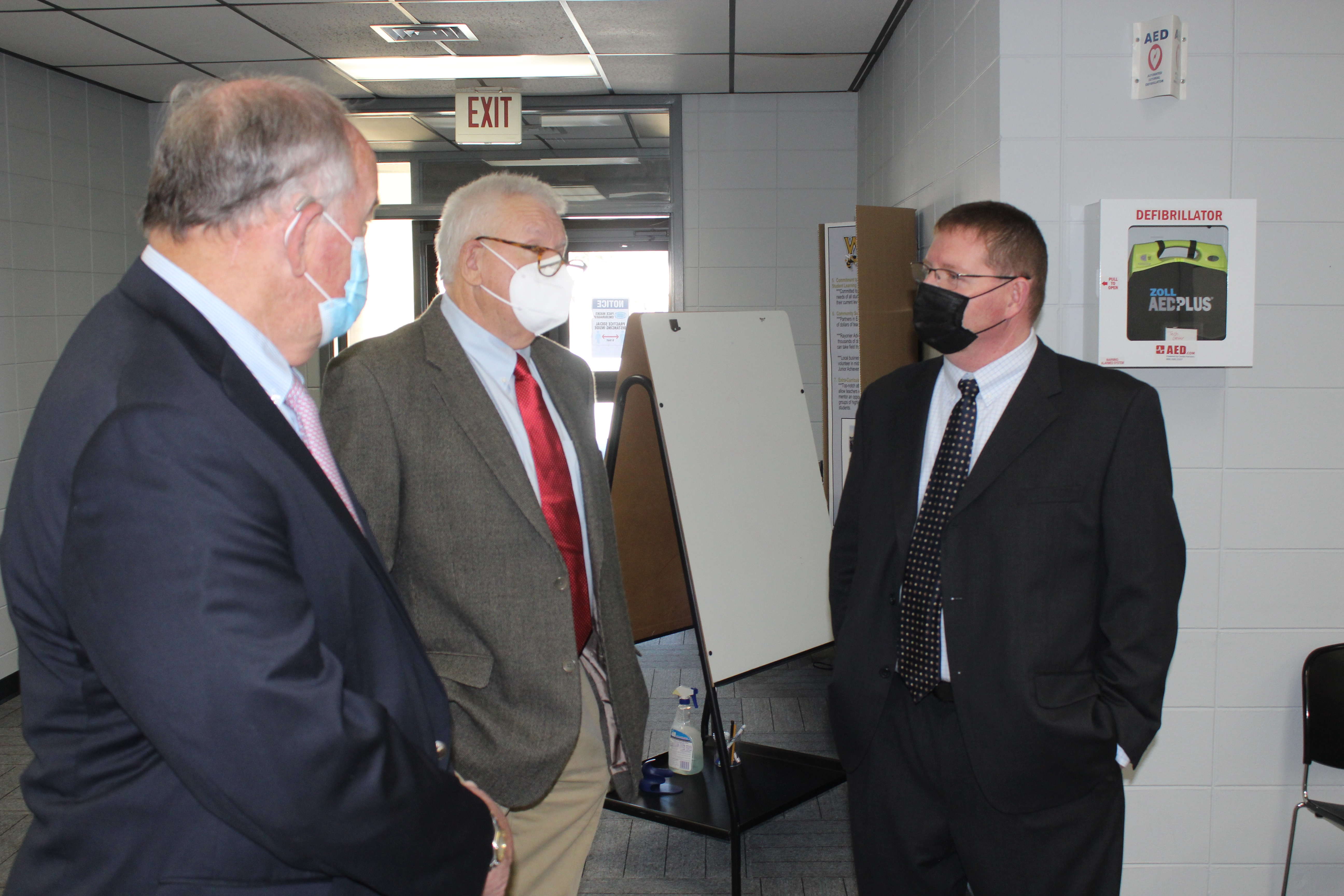 Newly hired to be Wayne County's school superintendent, Sean Kelly, right, talks with Board of Education members Joe McPipkin, left, and Ray Davidson about topics ranging from sports to the COVID-19 pandemic.