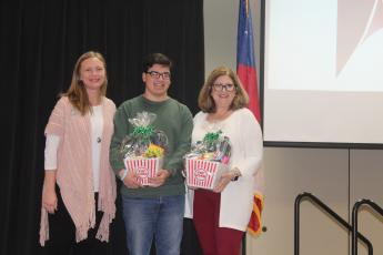 Jodi Lewis, left, of Marshland Credit Union presents gifts to STAR student Anthony Correa and his STAR teacher, Lynnah Welch. Marshland sponsored the STAR program for the Wayne County Chamber of Commerce this year.