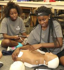 Student Athletic Trainer Camp 2019 attendees practice first aid techniques in Brunswick.