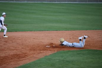 Zach Thomas slides in safely to second on a steal.