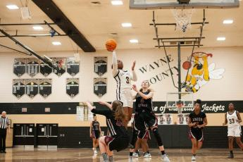 In recent state play, Terren Ward shoots over two Union Grove players for a basket. Ward was recently named the south Georgia AAAAA Player of the Year.