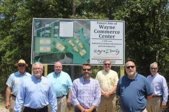 Gathering at the new Wayne Commerce Center sign are, from left, Wayne County Industrial Development Authority member Randy Franks; Authority Executive Director Dell Keith; Authority members Randy Teston, Bryan Griffis and Clay Bethea; Jesup City Commissioner Nick Harris; and Jesup Mayor David Earl Keith.
