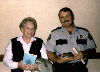 Sheriff John Carter, is joined by his mother, Eloise Carter, at the occasion of his graduation from the Police Academy in 1986. Sheriff Carter graduated No. 1 in his class and holds a plaque for the High Academic Award. He began his long career in the Wayne County Sheriff's Office in 1984 as a deputy under Sheriff Jim Poindexter and has served as sheriff since January 2005.