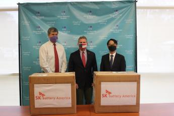 Wayne Memorial Hospital Administrator Joe Ierardi, left, accepts a donation facilitated by U.S. Rep. Buddy Carter, center, at the hospital last Thursday. SK battery America CEO Junho Hwang, right, brought the donation of 1,000 AirQueen KF94 nanofiber masks from the company's Atlanta office.