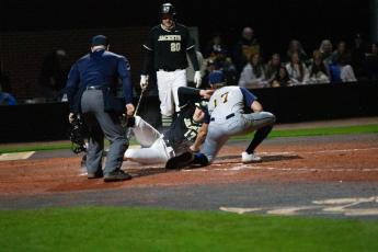 Zach Thomas slides into home against Jeff Davis High.